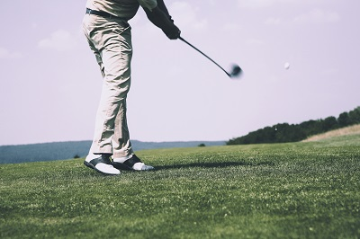 Golfer at a golfcourse